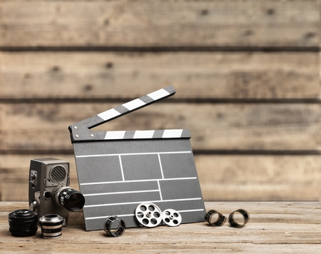 Classic clapperboard and lenses on brown