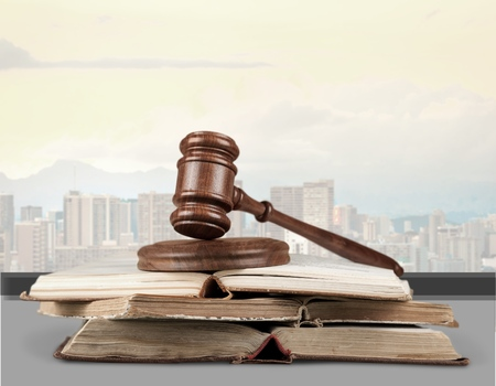 Justice law legal concept. Statue of justice with city background.