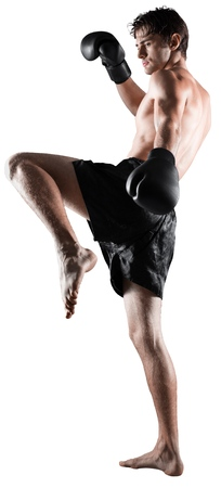 Male Boxer  Kickboxer Performing a Kick Stock Photo