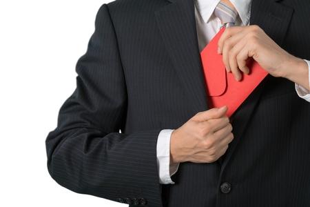 Businessman Putting an Envelope in his Pocket Stock fotó