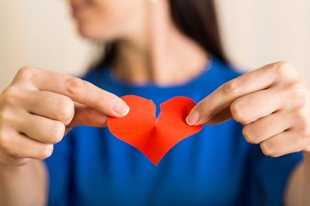 Female Hands Holding a Broken Heart
