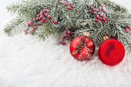 Christmas Decoration of Two Red Ornaments in Snow, Copy Space