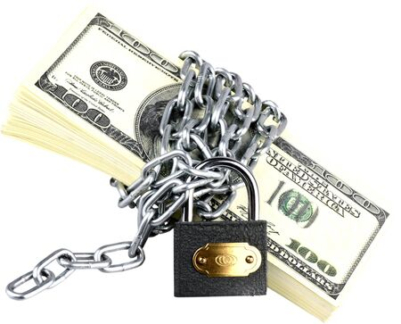 Stack of hundred dollar bills wrapped with a lock and chain Stock Photo