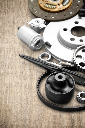 Car parts on wooden background