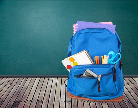 School bag on wooden table Stock Photo