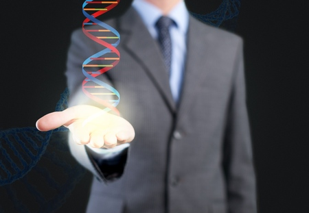 Businessman holding glowing DNA