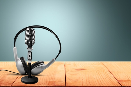 Retro microphone and headphones on table