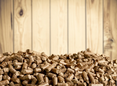 Pellets Biomass on wooden background