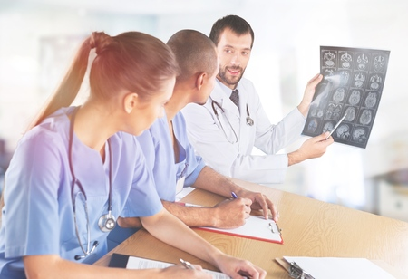 Doctors discussing computed tomography result