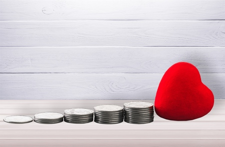 Coin money stack and red heart