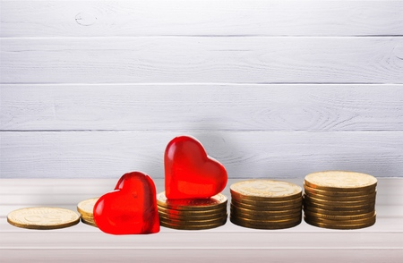 Coin money stack with red heart Stock Photo