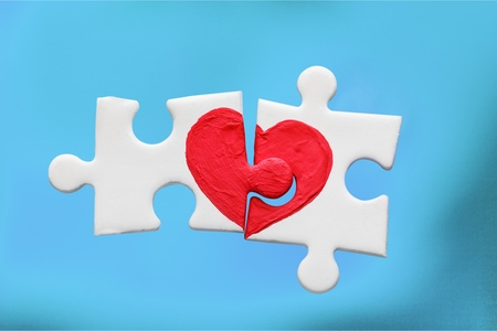 Two pieces of a puzzle with heart