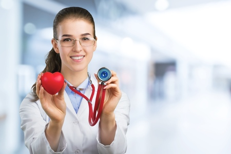 Female doctor hold red Stock Photo