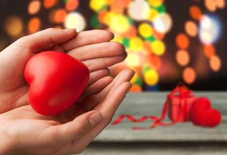 Human hand holding red heart Stock Photo