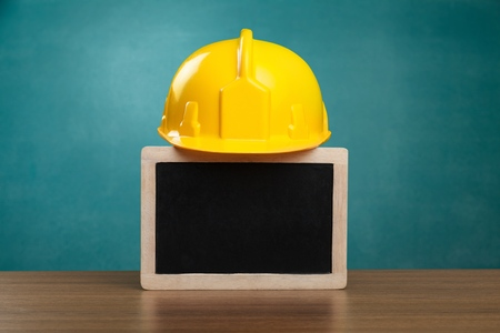 Safety helmet and white board with words Workplace Health and Safety,Health and Safety concept.