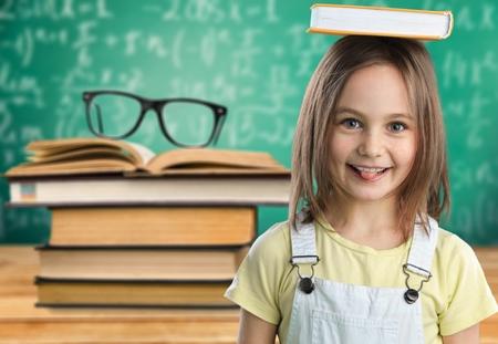 Happy kid girl with books Stockfoto