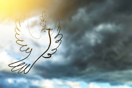 Silhouette of Dove carrying olive leaf branch .Freedom concept and World Peace Day and international day of peace 2016 Stock Photo