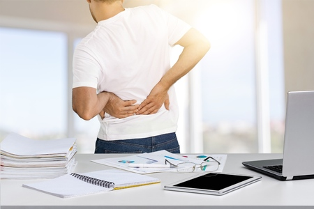 Business man with back pain in an office