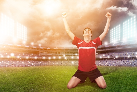 soccer player celebrating goal on a soccer field during the match Stock Photo