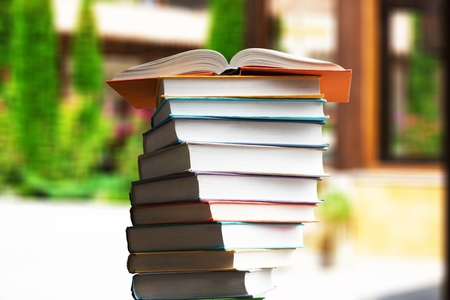 stack of books and open book