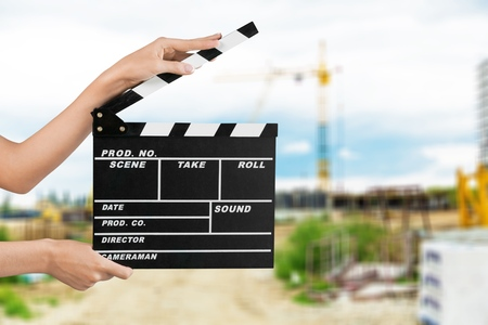 Human hand hands holding clapper board for making Stockfoto