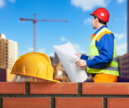 Bricklayer worker installing brick Stock Photo