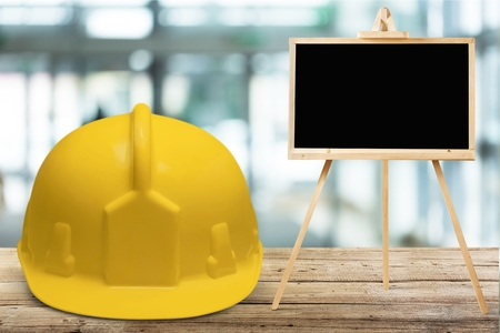 Safety helmet and black board Stock Photo