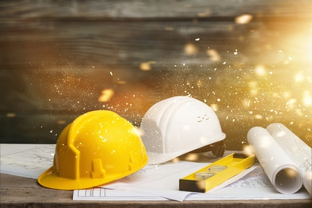 Business engineer contractor who contracts to supplies consulting about working their job at construction site office headquarters. Standard-Bild