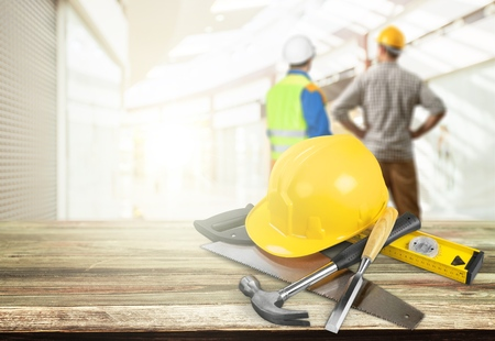 Business engineer contractor who contracts to supplies consulting about working their job at construction site office headquarters. Stock Photo