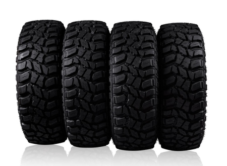 Pile of car tyres isolated on background