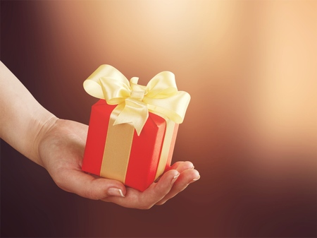 Girl hands holding a gift box