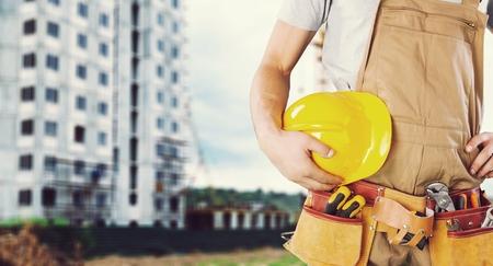 Construction worker with yellow helmet
