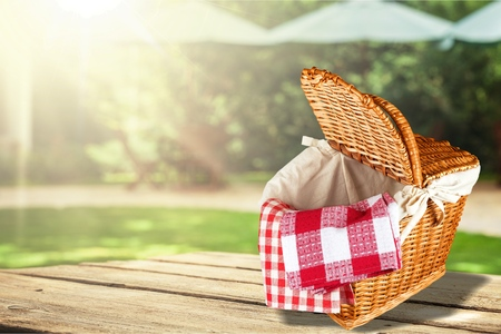 red napkin picnic basket and table place Stock Photo