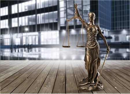 Statue of justice isolated on white background. Law concept Stock Photo