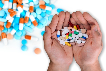Colorful pills and medicines in the hand