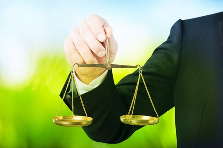 businessman hand holding a balance on white background Stock Photo