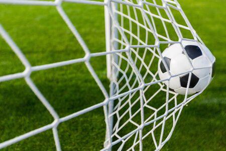 A Soccer Ball in a Net Stock Photo