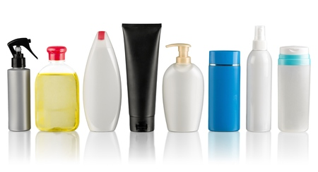 Set of different white, gray, green, blue bottles for beauty, hygiene and health on a white background with reflection, they shampoo, conditioner and hair products, each of them shot on separately