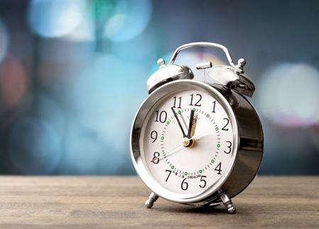 Retro alarm clock with retro colored Stock Photo