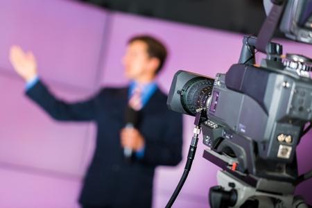 Closeup of a Video Camera Filming a TV Host 스톡 콘텐츠