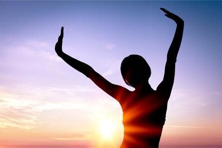 Siluet Woman on sunset backfround