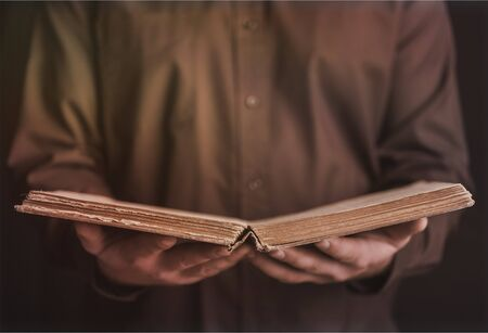 Man hands holding book Stock Photo
