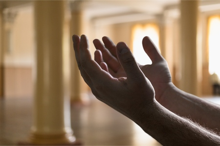 man praying inside the mosque