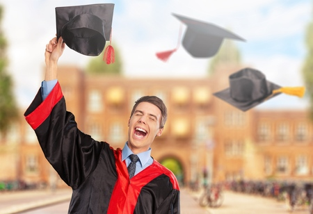 Graduates of the University,Of graduates holding hats handed to the sky. Stock Photo
