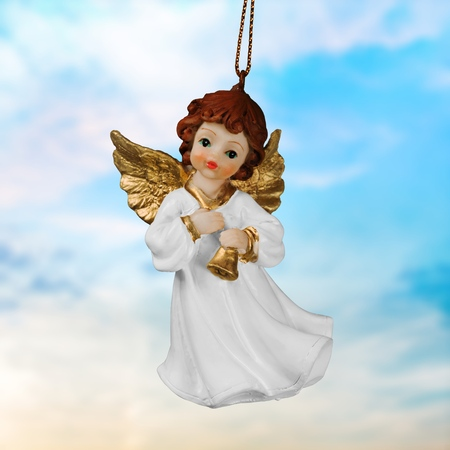 Beautiful angel in heaven with divine rays of sun light 스톡 콘텐츠