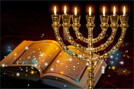 Low key Image of jewish holiday Hanukkah background with menorah (traditional candelabra) and burning candles
