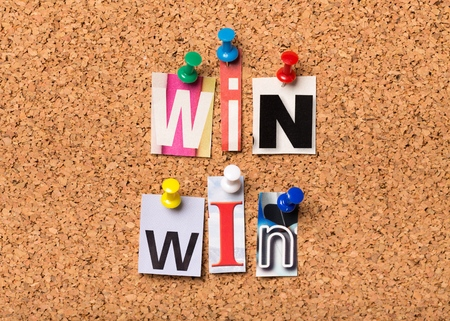 The phrase Win Win in cut out magazine letters pinned to a cork notice board. In any transaction or undertaking we look for mutual benefits and positive outcomes for all parties. Archivio Fotografico - 96388158