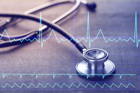 Heart monitor screen and stethoscope