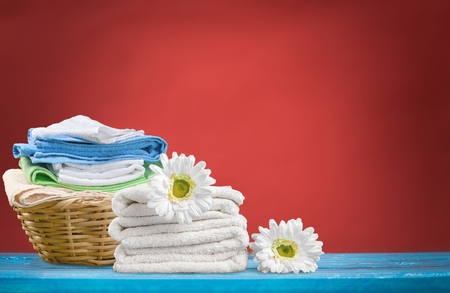 Laundry Basket with towels Stock Photo