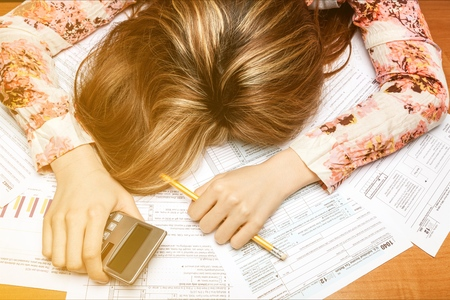 Woman exhausted from doing taxes 版權商用圖片